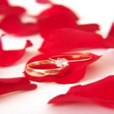 rose petals and wedding ring